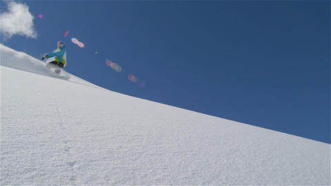 SLOW MOTION: Snowboarding on a perfect winter day Footage