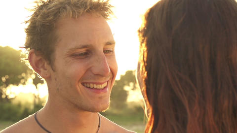 SLOW MOTION: Happy young couple kissing at golden  Footage