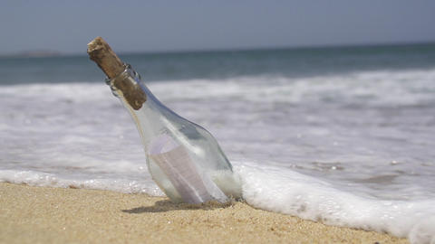 SLOW MOTION: Stranded bottle on the beach Footage