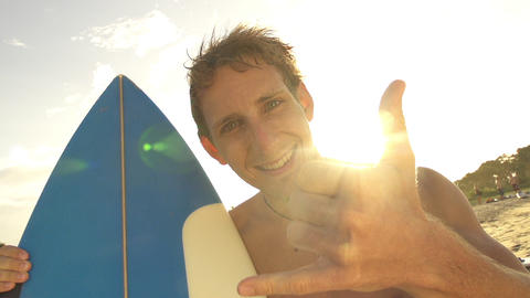 Cheerful young man showing surf sign with his hand Footage