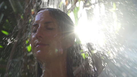 SLOW MOTION: Young woman showering Footage