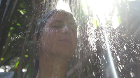 SLOW MOTION: Woman washing her hair at sunrise Footage