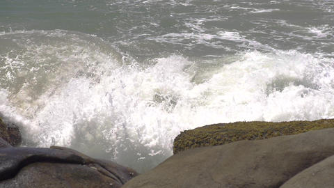 SLOW MOTION: Big waves hitting rocks Footage
