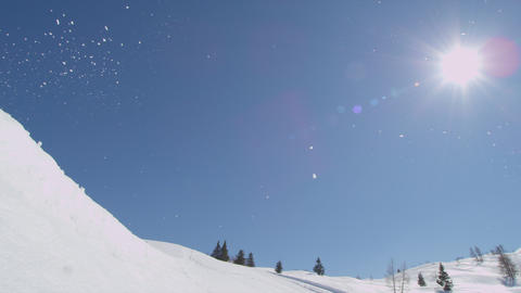 SLOW MOTION: Snowboarder does flip over the sun Footage