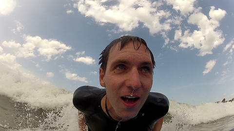CLOSE UP: Young Man Bodyboarding stock footage