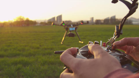 SLOW MOTION CLOSEUP: Drone Operator Holding A Tran stock footage