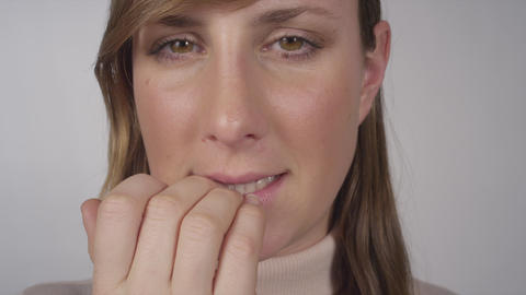 CLOSE UP: Nervous female biting her nails Footage