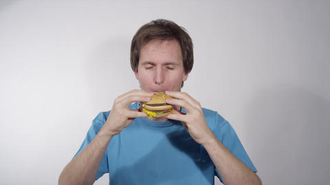 Young Man Eating Junk Food stock footage