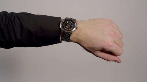CLOSE-UP: Businessman Checking The Time On His Wat stock footage