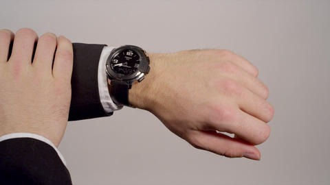 CLOSE-UP: Businessman checking the time Footage