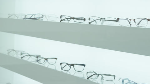 Glasses on the shelf in eye clinic Live Action