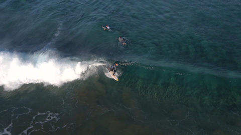 AERIAL: Surfer riding a big wave Footage