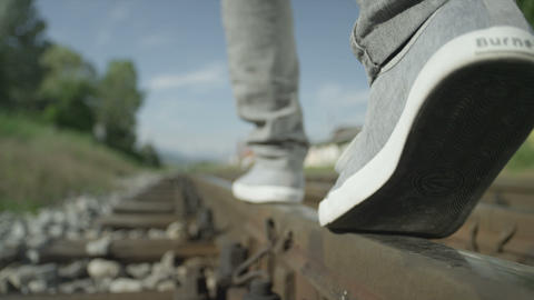 SLOW MOTION CLOSE UP: Man Walking On Railroad Trac stock footage