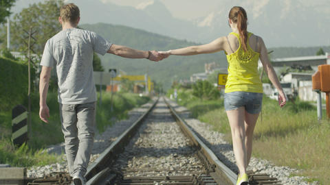 SLOW MOTION: Couple holding hands while walking on Footage