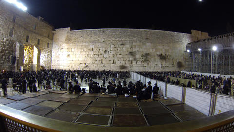 Jewish men (L) and women (R) pray in the Western W Footage