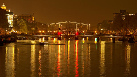 4K UHD Skinny Bridge Amsterdam, Holland, night, ti Footage