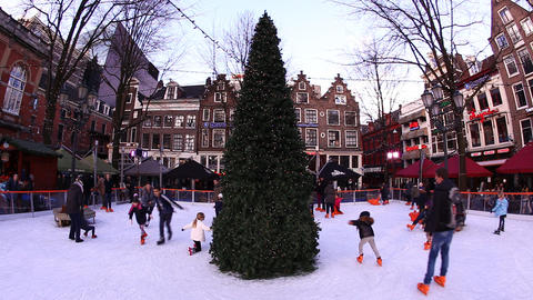 Dutch kids boys and girls enjoy ice skating around Footage
