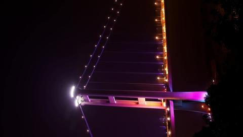 Vertical Tsing Ma Bridge in Hong Kong at night Footage