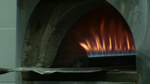 Baking Pita bread in brick oven Footage
