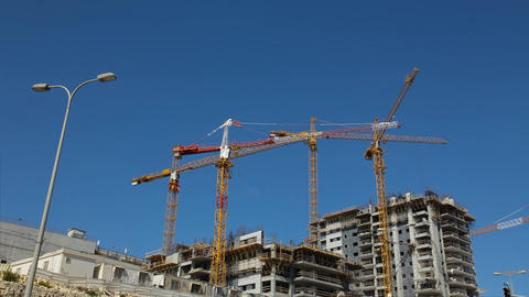 Cranes work in construction site time lapse Footage