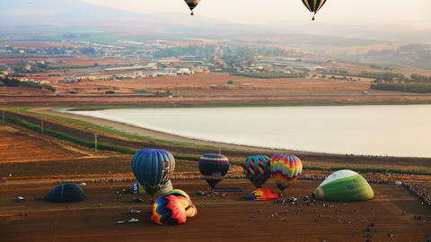 4K UHD Hot air balloons take off at sunrise aerial Footage