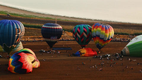 Hot Air Balloons Take Off At Sunrise Aerial Timela stock footage