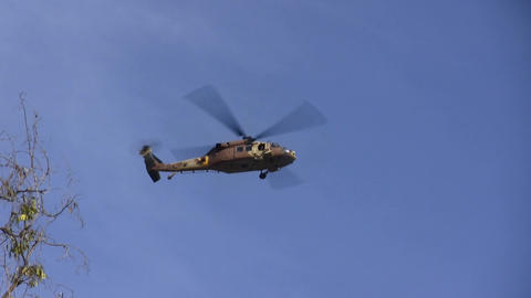 Israeli military helicopter hovers above demolitio Footage