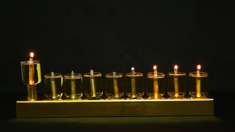 4 flames in Hanukia made of olive oil lanterns Footage