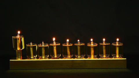 6 flames in Hanukia made of olive oil lanterns Footage