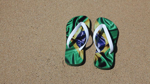 Brazilian Flip flops decorated with Brazil flag Footage