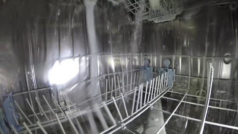 Dishwasher makes dishes glasses utensils clean and Footage