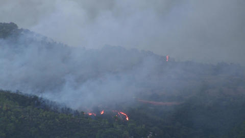 Airtankers spray against ferocious fire Footage