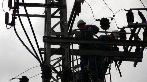 Electricians in a bucket fixing high voltage elect Footage