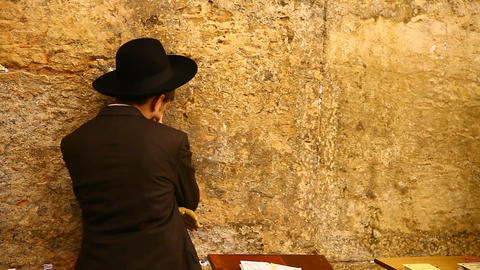 Orthodox Jewish Rabbi Prays At The Western Wall In stock footage