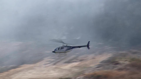 Israeli police helicopter inspects forest fire dam Footage