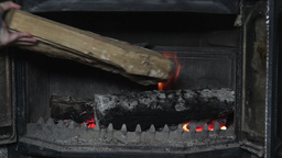 Fireplace - adding wood to the fire Footage
