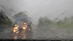 Rain storm. Driving a car in the rain storm Live Action