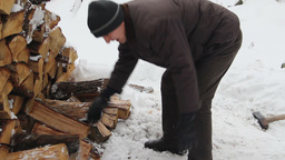 Man chopping wood in frosty winter. 2 Footage