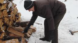 Man chopping wood in frosty winter. 2 Footage