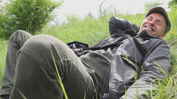 Happy man resting in the meadow Live Action