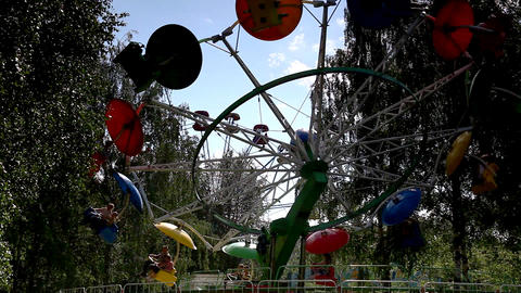 Carousel with people silhouette in park Stock Video Footage