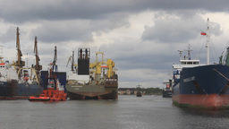 Tug boats tow the hopper dredger ship to the port Footage