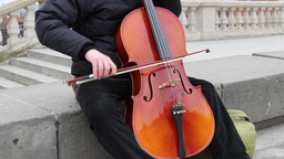 A street musician playing the cello 4 Footage