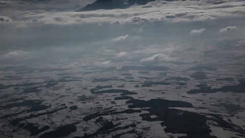 Clouds seen through the window of jet airplane FUL Footage