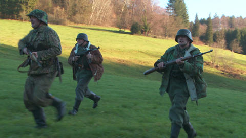 World War 2 German Soldiers running and ducking Footage