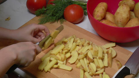Peeled Potatoes Cut Into Slices For Cooking stock footage