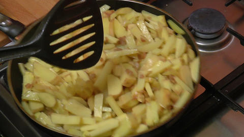 Frying Pan with Sliced Potatoes Live Action