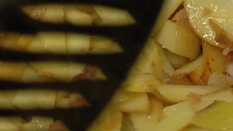 Frying Pan With Sliced Potatoes stock footage