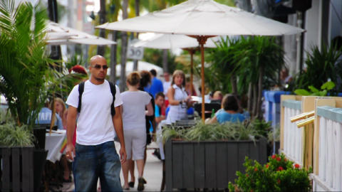 Man Walking On Ocean Drive In Miami Beach stock footage