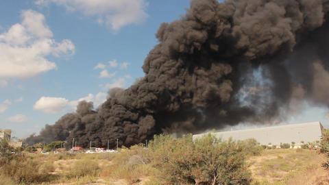 fire industrial firefighters battle blaze in packa Stock Video Footage